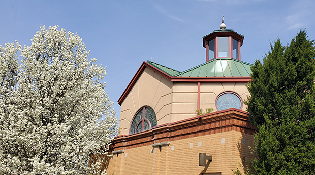 Chapel steeple with flowering trees