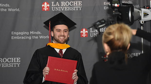 La Roche University graduate has photo taken as he exited the stage after receiving his diploma.