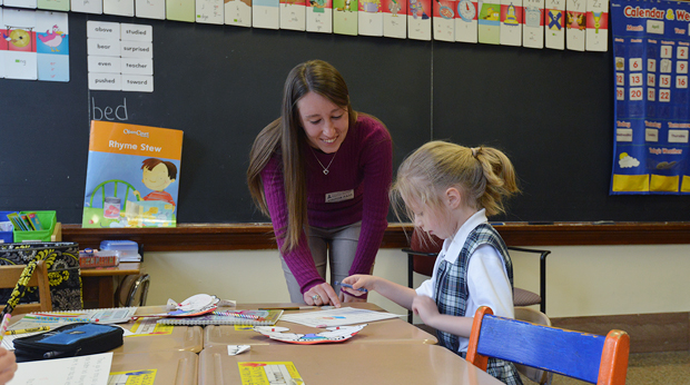 Student teacher at La Roche interacts with grade-school student in the classroom