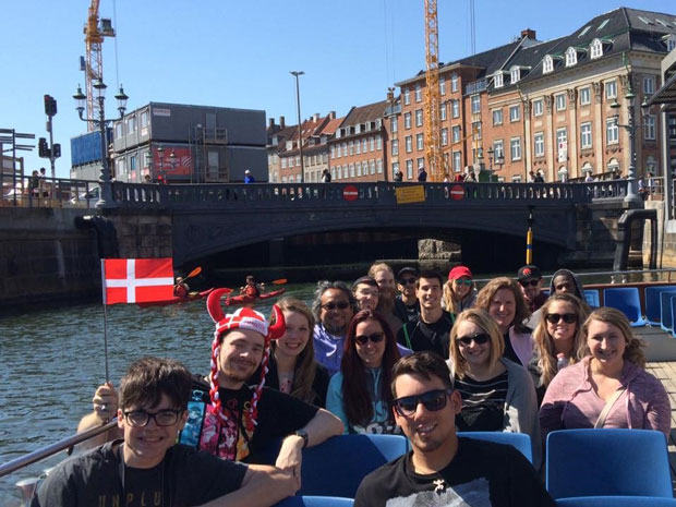 La Roche University students sitting on a boat during a Study Abroad+Study USA trip.