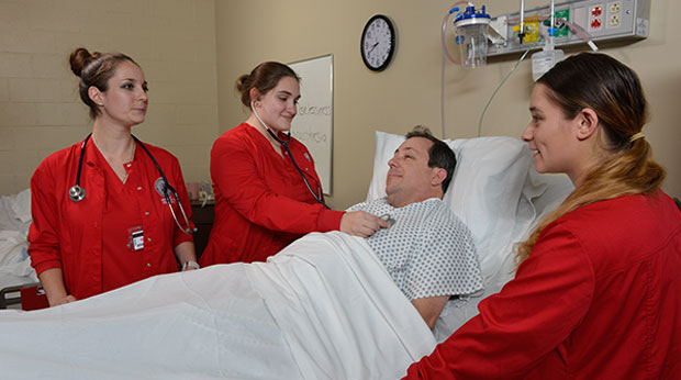 Students in La Roche University's Entry Level MSN program assess a patient.