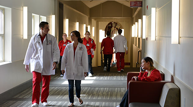 Nursing students walking hallway at La Roche University
