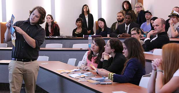 Students attending a presentation in class