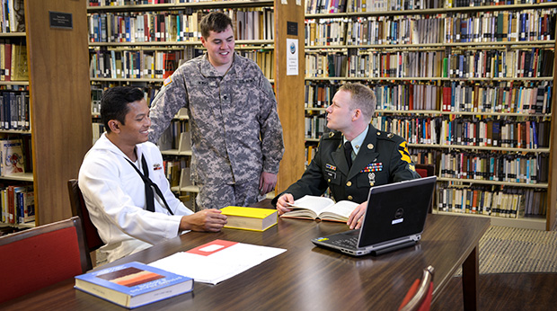 Military Students sitting at table in Library