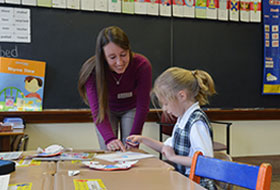 La Roche University student teacher in an elementary classroom with student