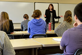 Janine Bayer, Ph.D. teaches a class to La Roche University students