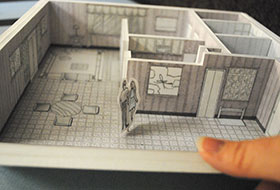La Roche University design student holding room layout project
