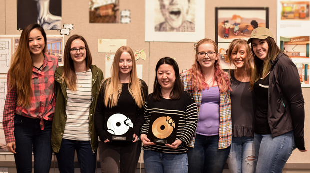 La Roche design students showing off artwork in the Cantellops Art Gallery