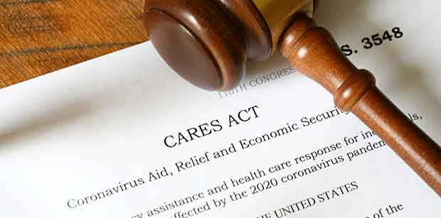 Photos of the 2020 Coronavirus Aid, Relief and Economic Security Act alos known as the CARES ACT. Photos are not of the actual bill but a simulation of the bill.